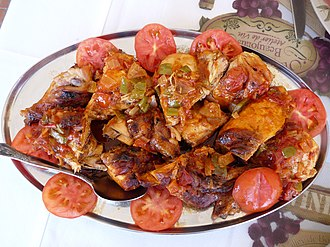 Cape Verdean cuisine - Grilled chicken with tomatoes, popular on the island of Fogo