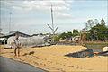 Séchage du riz au bord des routes (Delta du Mékong, Vietnam) (6635535829).jpg