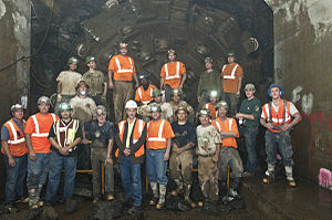 63rd Street Lines - Workers celebrate after the IND Second Avenue Line Tunnel Boring Machine reaches the BMT 63rd Street Line.