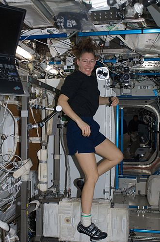 Sandra Magnus - Sandra Magnus, STS-119 mission specialist, exercises on the Cycle Ergometer with Vibration Isolation System (CEVIS) in the Destiny laboratory.