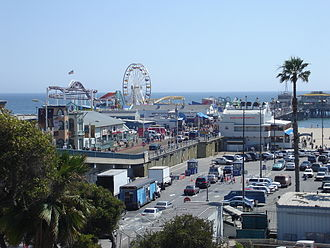 Santa Monica Pier - The pier with Pacific Park on the left (notice the Ferris wheel was different and the roller coaster track was purple, not yellow), 2006.