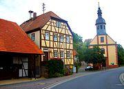 Schweinberg (municipality Hardheim) townhall + church.JPG
