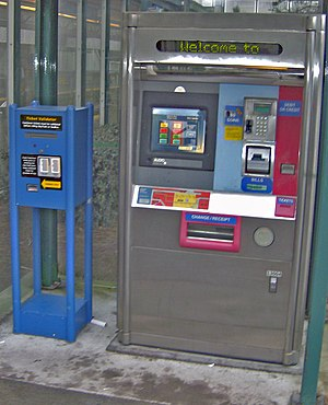 SkyTrain (Vancouver) - A ticket vending machine (right), next to an old faresaver validator