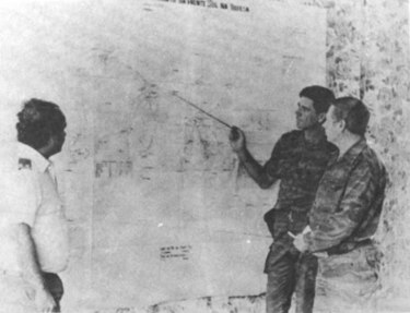 Soviet military advisers planning operations during the Angolan Civil War (1975-2002), a proxy conflict involving the U.S.S.R and United States Soviet advisers planning military operations Angola.jpg