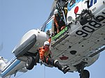 Special Rescue Team officer abseiling from AS332 helicopter.jpg