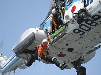 Japan Coast Guard - A SRT officer abseiling from an AS332L1 helicopter.