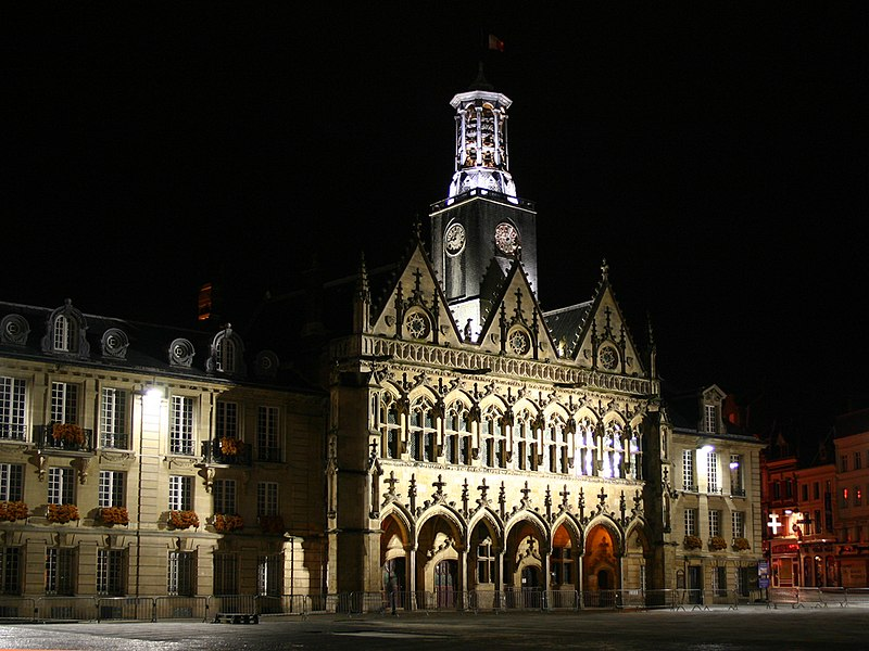 The floodlit facade of the town hall at St Quentin