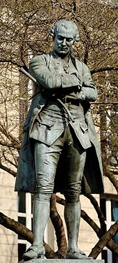 Statue of Beaumarchais by Louis Clausade[fr] (1895), in the 4th arrondissement of Paris (Source: Wikimedia)