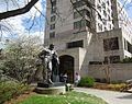 Statue and students and grass and building at Cornell University.jpg