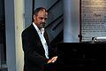 "Stavros V. Kyriakides at the piano during ""Kyriakides Piano Gallery's Vigintennial Anniversary"", November 2013.jpg"