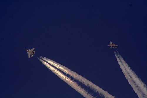 Indian Air Force's Sukhoi Su-30MKIs during a Thach Weave manoeuvre. Su-30 MKI's.jpg
