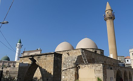 The Old Mosque (Sunna), with the Abdul Hussein Mosque (Shia), built in 1928, in the back left Sunna-Shia-Mosques TyreSourLebanon RomanDeckert24082019.jpg