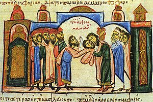Theophanes (chamberlain) - The parakoimomenos Theophanes (right, kissing the image) receives the Mandylion. Miniature from the Madrid Skylitzes.