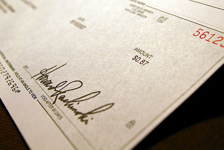 A check, used as a means of converting funds in a demand deposit to cash Sweet success.jpg