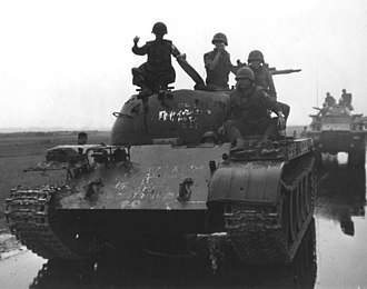 ARVN soldiers posing on top of a Type 59 tank T-59 VC.jpg