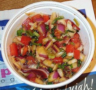 Poke (fish salad) - He'e (octopus) poke with tomatoes, green onion, maui onion, soy sauce, sesame oil, sea salt, and chili pepper