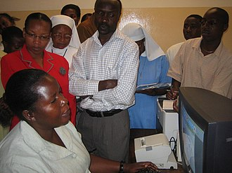 Women in the workforce - A woman employee demonstrates a hospital information management system in Tanzania.