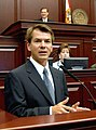 Thad Altman comments to colleagues from the House floor podium.jpg