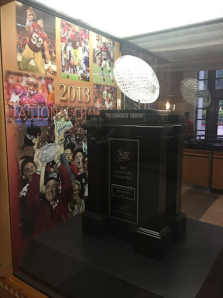 The BCS National Championship trophy on display at Florida State University. The 2013 Championship game marked the end of the BCS era. The 2013 College Football National Championship Trophy display at the Moore Athletic Center.jpg