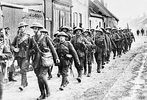 54th Infantry Brigade (United Kingdom) - A platoon of 'D' Company of the 7th (Service) Battalion, Bedfordshire Regiment passing through a French village on its way to the line, sometime in 1916. The officer at the head of his platoon is Lieutenant Douglas Keep, who was killed in action the following year.