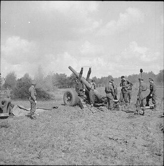 London Heavy Brigade, Royal Garrison Artillery - 5.5-inch gun of 64 Med Rgt firing at Bremen, 24 April 1945.