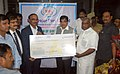 The Chairman & Managing Director, Kamarajar Port Ltd., Shri A. Baskarachar handing over a dividend cheque for Rs 64 Crore to the Union Minister for Road Transport & Highways, Shipping, Rural Development.jpg