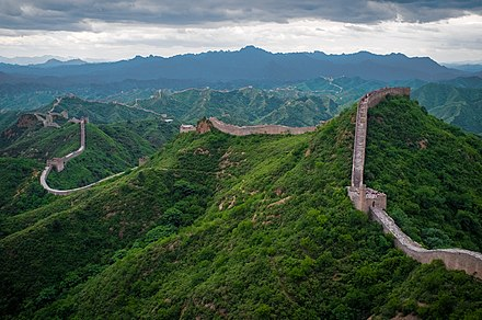 Remnants of the Great Wall of China in the mountains north of the city. The Great Wall of China at Jinshanling-edit.jpg