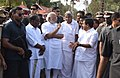 The Prime Minister, Shri Narendra Modi and the Chief Minister of Kerala, Shri Oommen Chandy, takes stock of the situation at Puttingal temple, Paravur, in Kollam, Kerala on April 10, 2016 (2).jpg