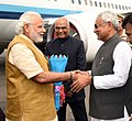 The Prime Minister, Shri Narendra Modi being welcomed by the Governor of Bihar, Shri Ram Nath Kovind and the Chief Minister of Bihar, Shri Nitish Kumar, on his arrival, at Patna Airport, in Bihar on March 12, 2016 (1).jpg