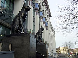 Carreras Cigarette Factory - The black cats on guard in front of the building