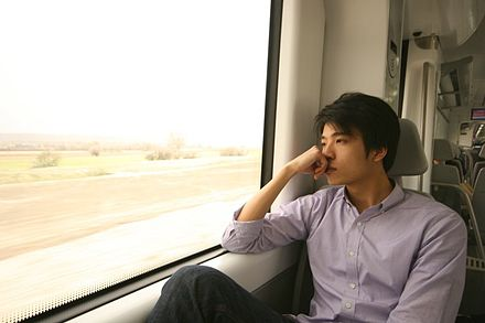 Man thinking on a train journey Thinking2.jpg