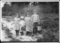 Three pickers going home from work. Anne, 7 years old, and brother Vincent said 11. Vincent picked last summer. Inez... - NARA - 523465.tif