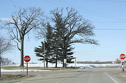 The intersection of County D and B in rural town of Farmington during winter