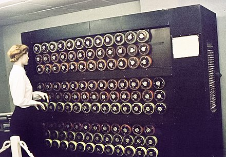 The Bombe replicated the action of several Enigma machines wired together. Each of the rapidly rotating drums, pictured above in a Bletchley Park museum mockup, simulated the action of an Enigma rotor. TuringBombeBletchleyPark.jpg