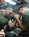 Two U.S. Marines assigned to the 11th Marine Expeditionary Unit (MEU) arm wrestle on the mess deck of amphibious assault ship USS Makin Island (LHD 8) during a Moral, Welfare and Recreation (MWR) fun day in 111211-N-ZZ999-105.jpg