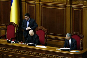 7th Ukrainian Verkhovna Rada - Oleh Tyahnybok (standing), Oleksandr Turchynov (left) and Ruslan Koshulynskyi (right) in parliament on February 24, 2014.