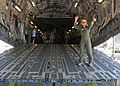 U.S. Air Force Capt. Tammy Ostrowski directs foot traffic aboard a C-17 Globemaster III aircraft during Exercise Golden Eagle III at Stewart Air National Guard Base, N.Y., June 1, 2013 130601-Z-VX101-021.jpg