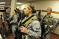 U.S. Air Force Senior Airman Kathleen Stenger, foreground, with the 219th Security Forces Squadron, North Dakota Air National Guard (NDANG), stands in formation with fellow security specialists during a briefing 130521-Z-WA217-116.jpg