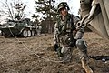 U.S. Army Sgt. Daniwel Dana with Lightning Troop, 3rd Squadron, 2nd Cavalry Regiment, hooks a tow cable to a Stryker armored vehicle during a mission rehearsal exercise (MRE) at the Joint Multinational Readiness 130308-A-PU716-003.jpg