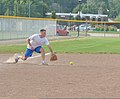 U.S. Coast Guard Lt. Cmdr. Jason Biggar, the chief of the planning department at Coast Guard Civil Engineering Unit Cleveland, fields a ground ball during his unit's softball practice July 31, 2013 130731-G-KB946-073.jpg