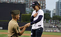 U.S. Marine Corps Sgt. William McGregor, left, the driver for the commanding general of the 3rd Marine Aircraft Wing, proposes to his long-time girlfriend, Julie Terry, after throwing the first pitch at a San 130602-M-NF414-254.jpg