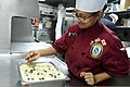 U.S. Navy Culinary Specialist 2nd Class Rupa Raass prepares a dish for dinner aboard the guided missile destroyer USS McCampbell (DDG 85) March 14, 2013, in the Yellow Sea 130314-N-TG831-137.jpg