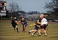 U.S. Navy Lt. Cmdr. Alex Hampton, second from left, hands the ball off to Lt. Cmdr. James Prosek, both students at the U.S. Naval War College (NWC), during an Army-Navy flag football game at Nimitz Field 131206-N-PX557-272.jpg