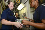 U.S. Navy Midshipman 1st Class Michelle Aylor, left, a student at Virginia Polytechnic Institute and State University, helps Sailors move supplies during a replenishment at sea aboard the aircraft carrier USS 130622-N-TW634-122.jpg