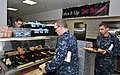 U.S. Navy recruits wait in the cafeteria line to receive food inside the galley of the USS Triton Barracks at Recruit Training Command at Naval Station Great Lakes, Ill. 121031-N-IK959-269.jpg