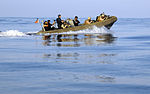 U.S. Sailors from the visit, board, search and seizure team assigned to USS Chosin (CG 65) and a U.S. Coast Guard maritime safety and security team use a rigid-hulled inflatable boat to approach a dhow in 100101-N-GQ684-157.jpg