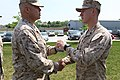 U. S. Marine Lt. Col. Dion A. Anglin, 4th Reconnaissance Battalion commander, presents Staff Sgt. Alec Haralovich with the Gunnery Sgt. John Basilone Award for Courage and Commitment during a ceremony 130519-M-MS727-039.jpg