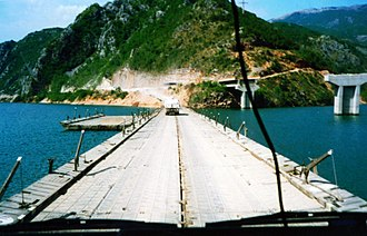 United Nations Protection Force - Dutch UN Transportbatallion crossing a Pontoon bridge over the river Neretva. Bosnia and Herzegovina, early 1995