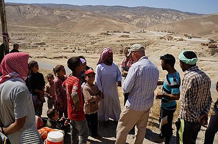 Yazidi refugees and American aid workers on Mount Sinjar in August 2014 USAID Mt Sinjar.jpg