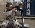 USMC checking rifle.JPEG